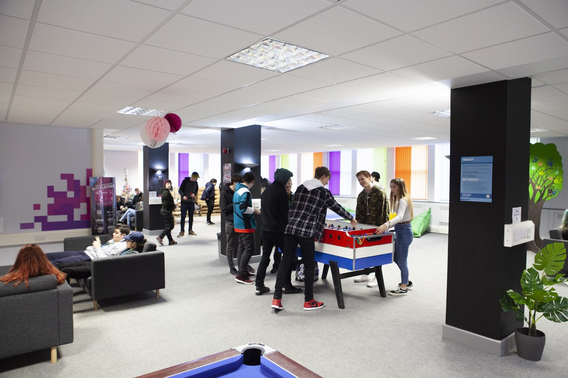 Cornwall College St Austell student zone called The Space - wide shot of whole room
