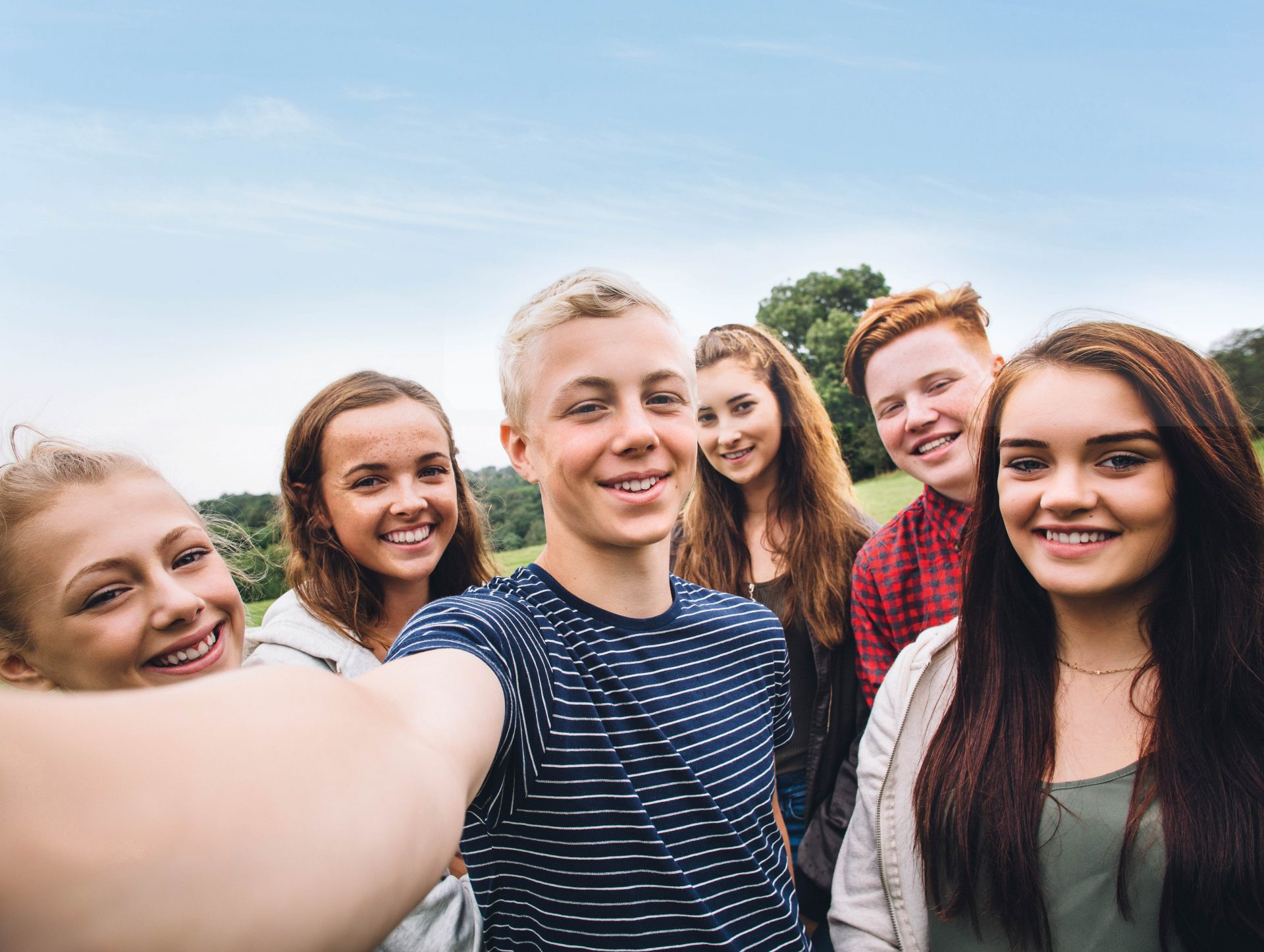 Students smiling at the camera in a group