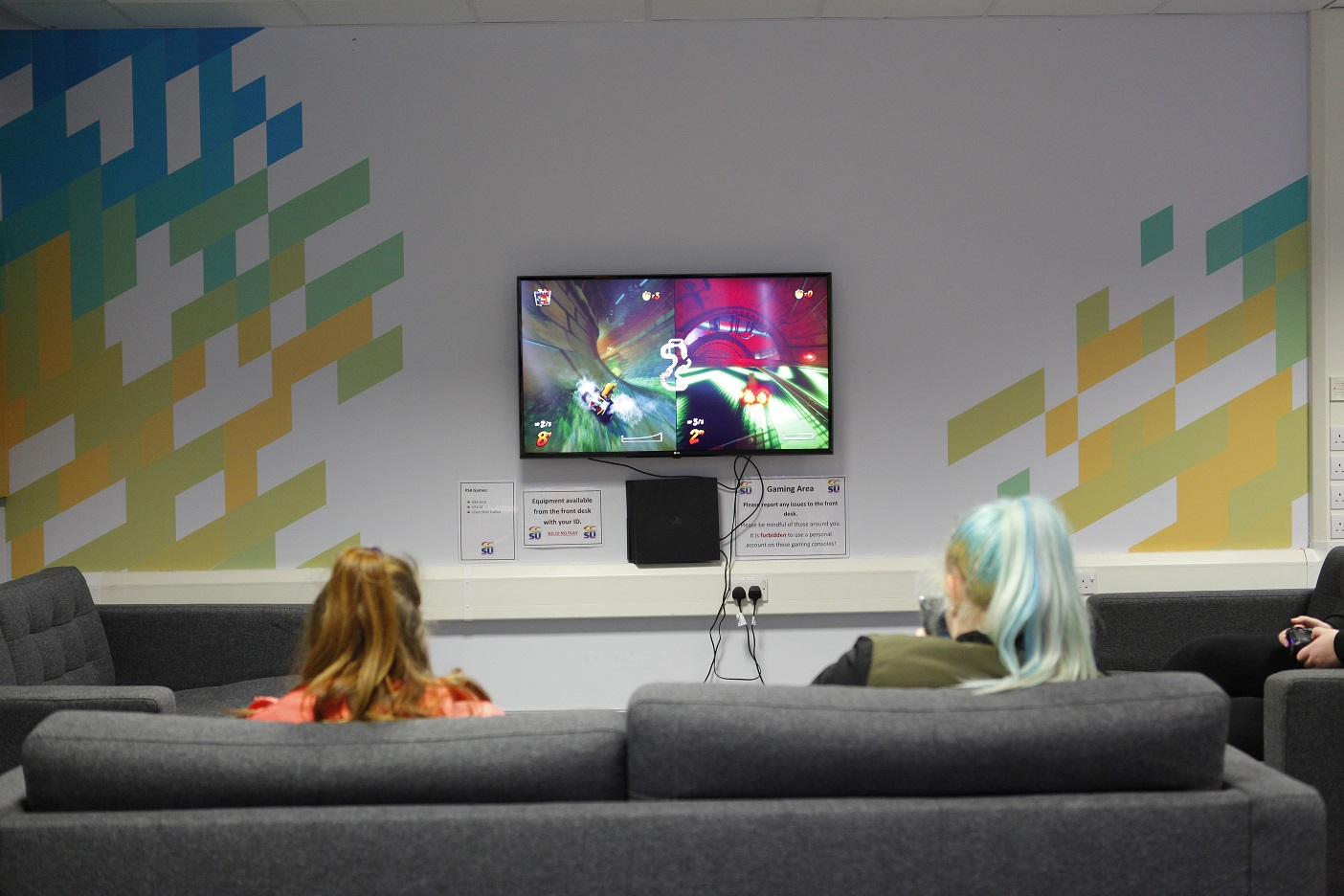 Students gaming in The Space - student common room at Cornwall College St Austell