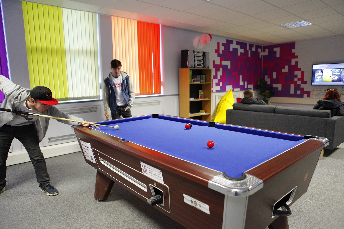 Students playing pool in The Space - student common room at Cornwall College St Austell
