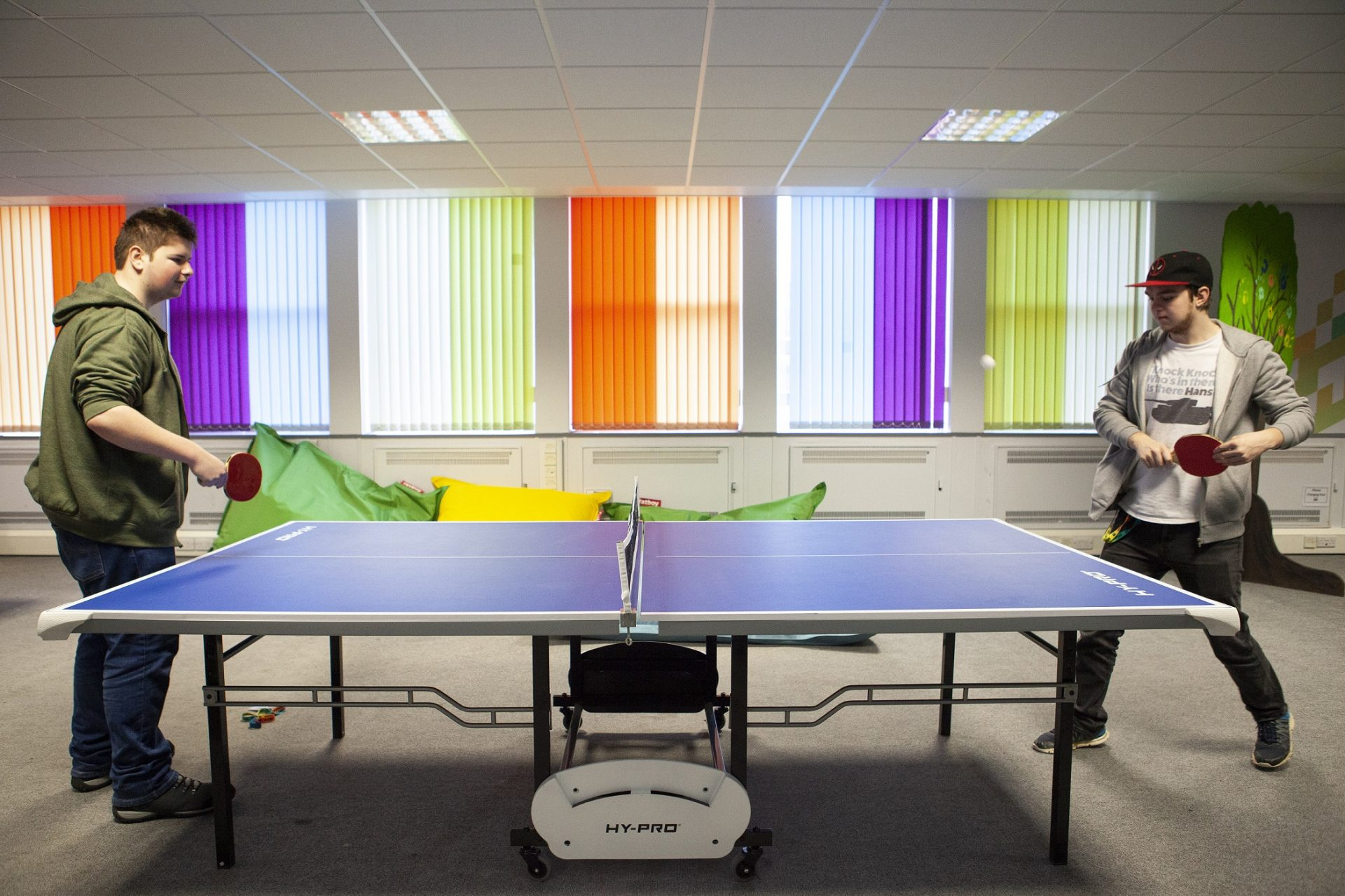 Cornwall College St Austell student zone called The Space - students playing table tennis