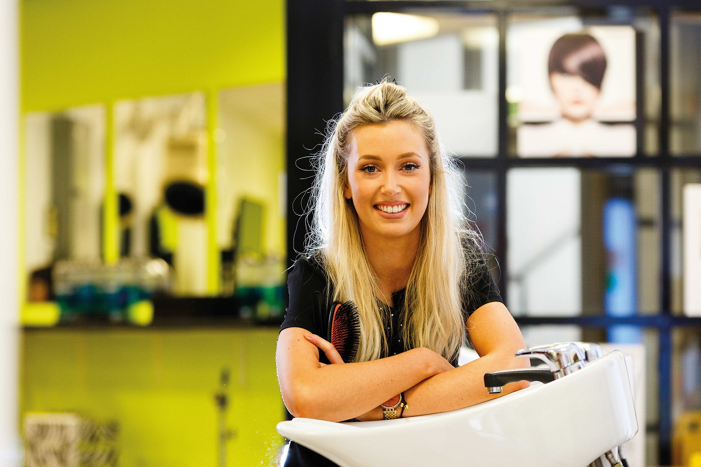 Cornwall College hairdressing student in college training salon