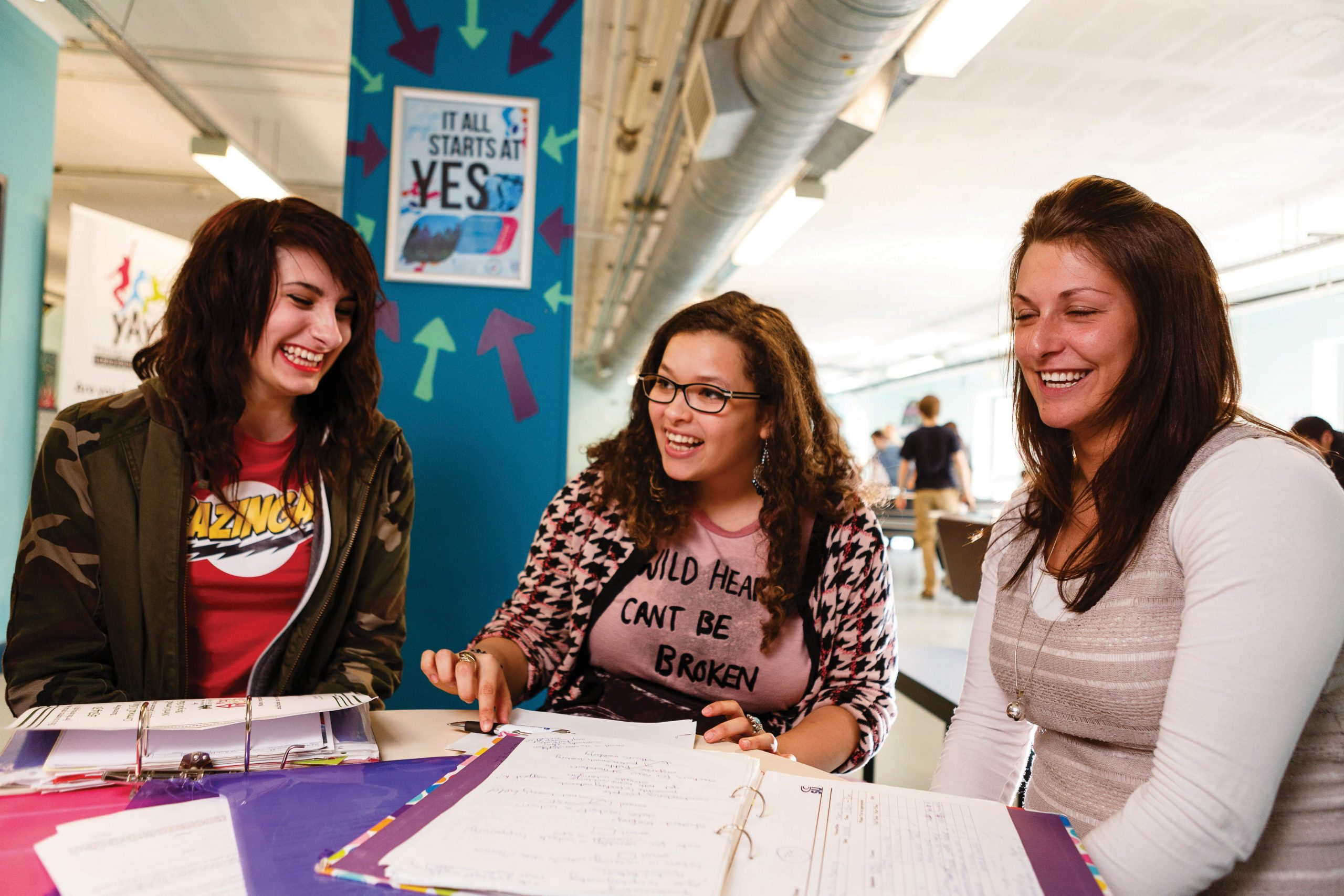 Three students having a chat at the Student Union at St Austell campus